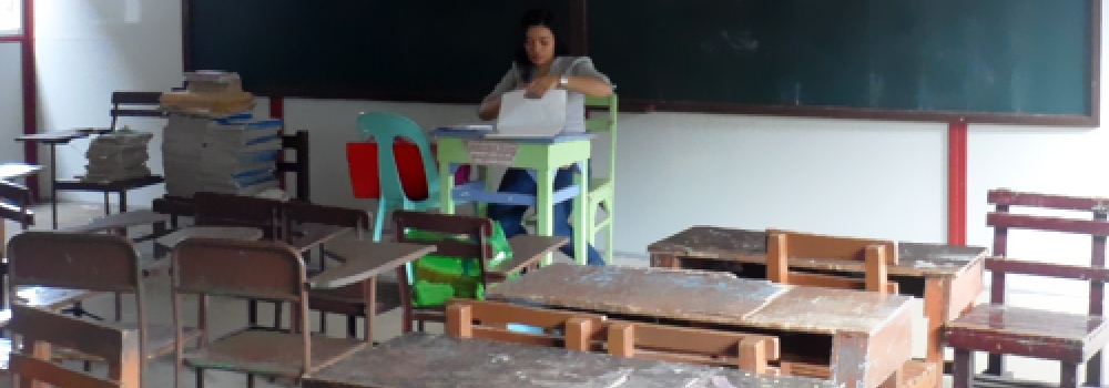 A teacher prepping up her material for the start of classes.